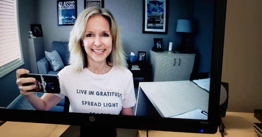 "Michelle on screen with a ""live in gratitude"" Tshirt"