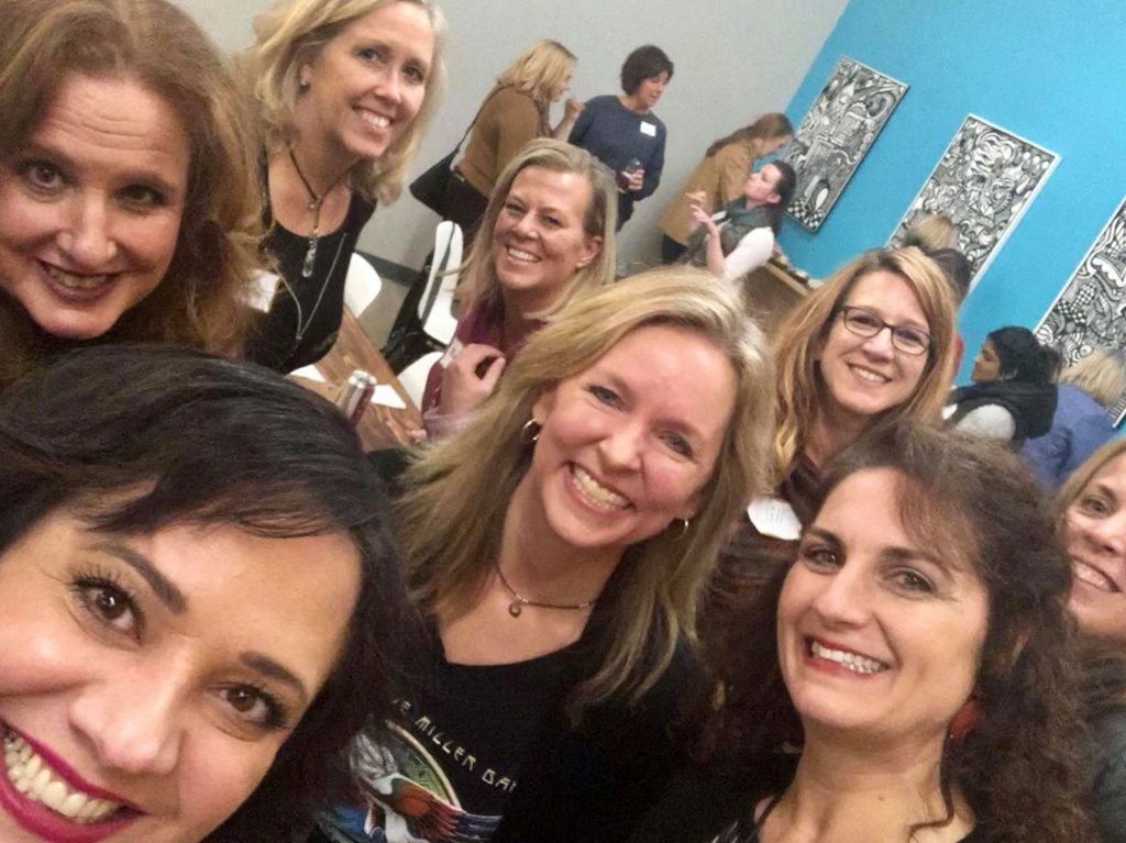 Women group photo for Fall Winter 2018 Client & Guest Happy Hour blue wall room in Edina, Minnesota